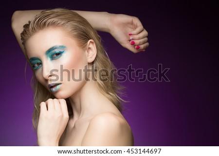 Aqua princess. Closeup shot of a stunning futuristic fashion model wearing creative metallic blue makeup looking to the camera copyspace on the side - stock photo