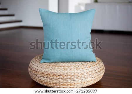 Aquamarine blue pillow in white interior - stock photo