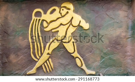Aquarius sign of horoscope on the wall - stock photo
