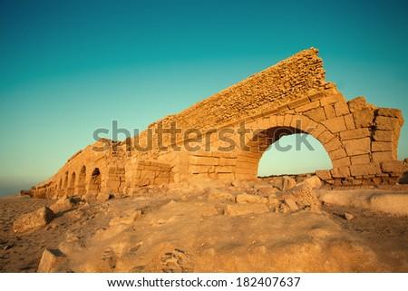 Aqueduct in ancient city Caesarea in Israel   - stock photo