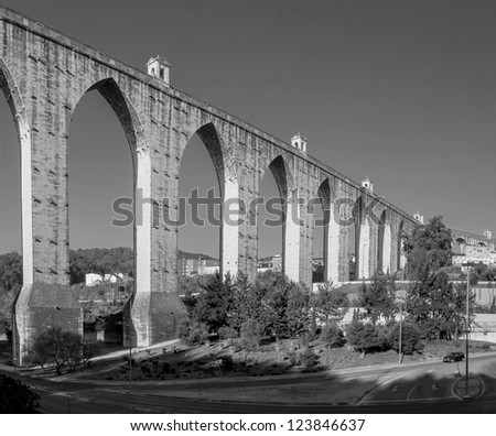 Aqueduct in the Lisbon built in 18th century, Portugal (black and white) - stock photo
