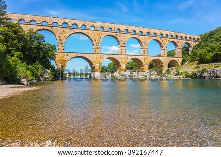 Aqueduct Pont du Gard - the highest in Europe. The bridge was built on the river Gardon in Provence. France, spring sunny day - stock photo
