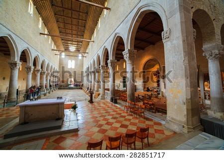 AQUILEIA, ITALY - MAY, 01: Basilica di Santa Maria Assunta with unique mosaics in Aquileia, UNESCO World Heritage Site on May 01, 2015 - stock photo