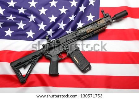 AR-15 (M4A1) custom carbine on the flag of USA - stock photo