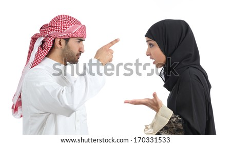 Arab couple discussing angry isolated on a white background                - stock photo