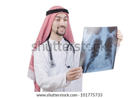 Arab doctor examining x-ray print - stock photo