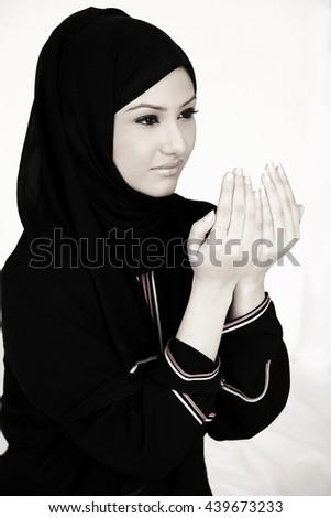 Arab lady praying - stock photo