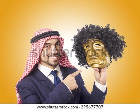 Arab man hypocrisy concept - stock photo