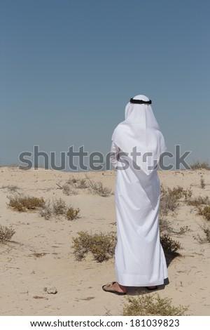 Arab man in the desert - stock photo