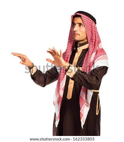 Arab man pressing virtual button on white background - stock photo