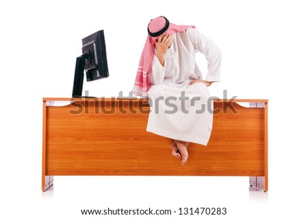 Arab man sitting at his desk - stock photo