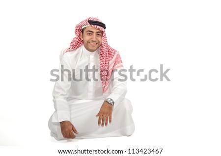 Arab man sitting on the floor - stock photo