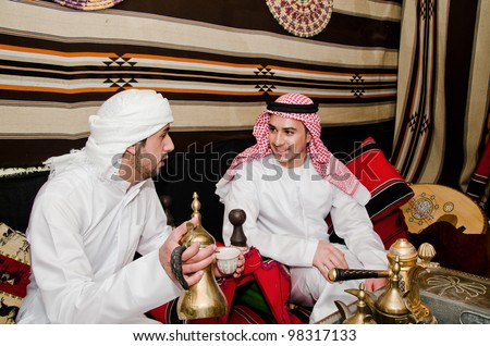 Arab men setting in traditional tent - stock photo