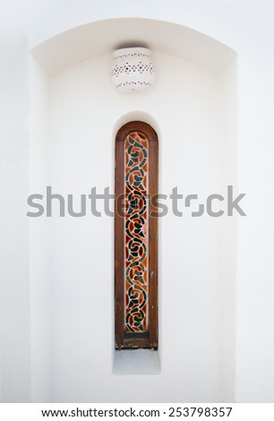 Arab narrow window with stained glass. - stock photo