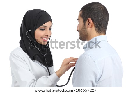 Arab saudi doctor woman examining patient isolated on a white background           - stock photo