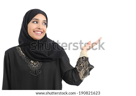 Arab saudi emirates woman promoter presenting looking at side              - stock photo