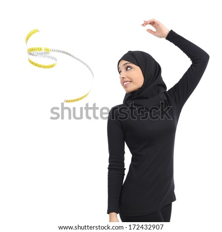 Arab saudi fitness woman throwing a measure tape isolated on a white background                - stock photo