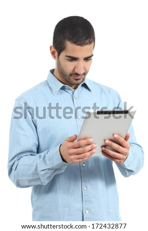 Arab saudi man reading a tablet reader isolated on a white background               - stock photo