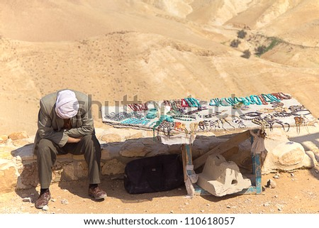 Arab selling traditional gifts in Judean desert (Israel) - stock photo