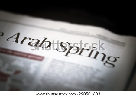 Arab Spring written newspaper, shallow dof, real newspaper. - stock photo