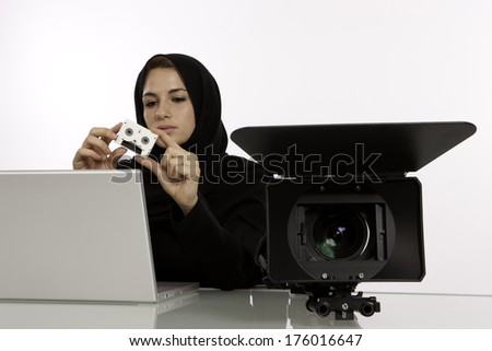 Arab Student Editor Holding Her Final Cut In A Studio - stock photo