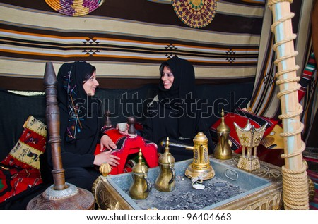 Arab Women sitting in a traditional tent - stock photo