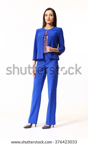 arabian asian eastern brunette business executive woman with straight hair style in blue jacket and trousers suit high heels shoes full length body portrait standing isolated on white - stock photo