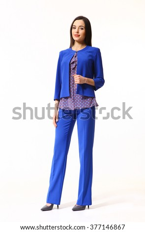 arabian asian eastern brunette business executive woman with straight hair style in blue suit jacket trousers two pieces high heels shoes full length body portrait standing isolated on white - stock photo