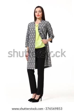 arabian asian eastern brunette business executive woman with straight hair style in trench coat black trousers high heels shoes full length body portrait standing isolated on white - stock photo