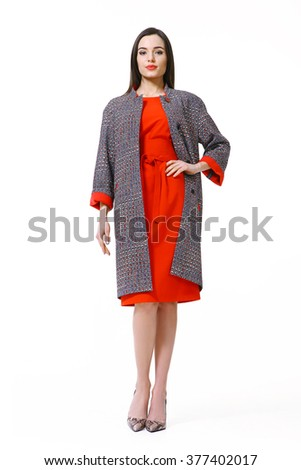 arabian asian eastern brunette business executive woman with straight hair style in woolen coat and red dress high heels shoes full length body portrait standing isolated on white - stock photo