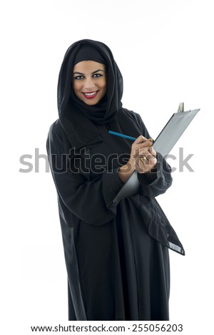 Arabian business woman holding a clipboard isolated on white - stock photo