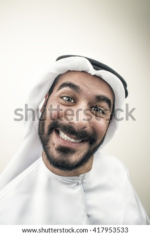 Arabian businessman Smiling, Arabian guy with silly expression  - stock photo