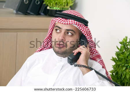 Arabian Businessman talking on phone  - stock photo