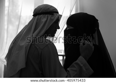 Arabian couple intimate at home - stock photo