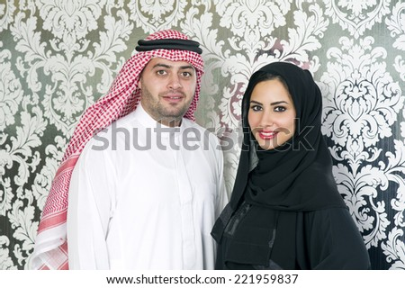 Arabian couple posing - stock photo