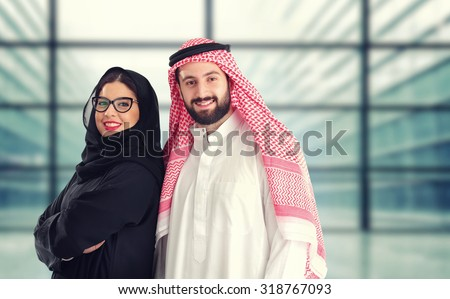 Arabian couple standing a business center - stock photo