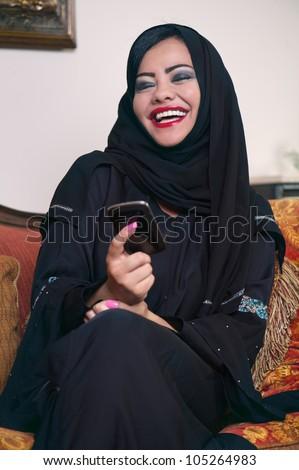 arabian lady with hijab having fun while chatting - stock photo