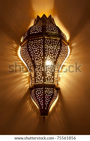 Arabian lamp with beautiful shadows on wall. Concept for Moroccan and Arabian culture and design. - stock photo