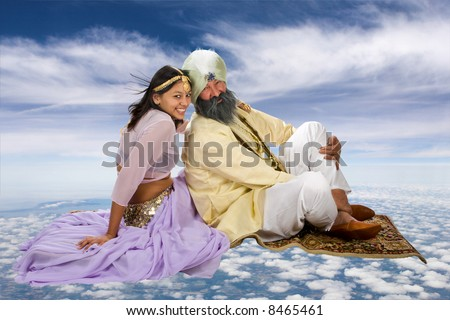 Arabian story of Scheherazade and her Sultan on a flying carpet - stock photo