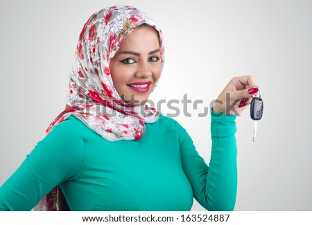 Arabian woman holding car keys - stock photo
