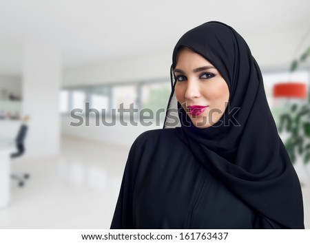 Arabian woman posing in a business center - stock photo