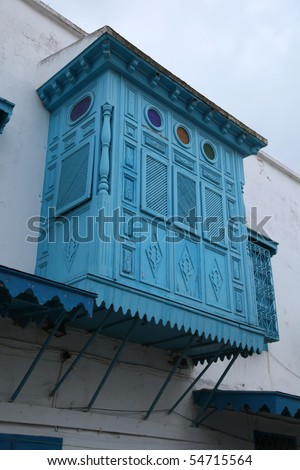 arabic blue wooden balcony in old city street - stock photo