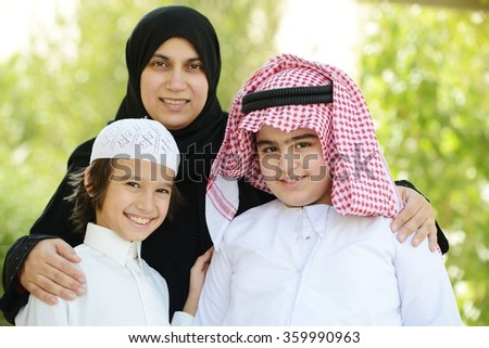 Arabic boys with mother - stock photo