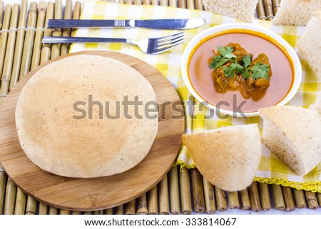 arabic bread with asian beef curry - stock photo