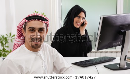 Arabic business couple working. Focus is on the man. - stock photo