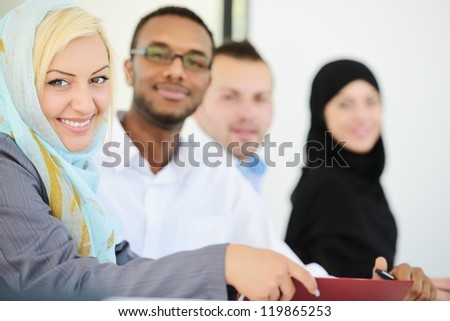 Arabic business group sitting in a row line - stock photo
