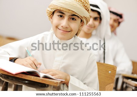 Arabic children in school classroom - stock photo