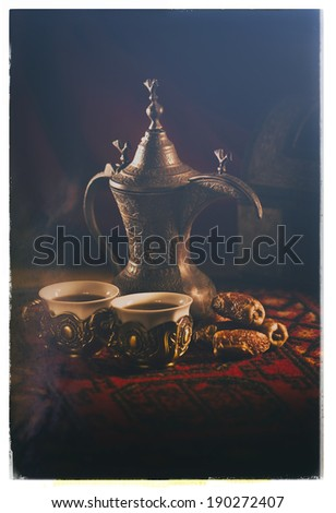 Arabic coffee and dates set up- Vintage style photograph - stock photo