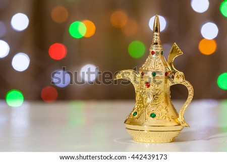 Arabic Coffee pot colorful out of focus light as background. Ramadan, Eid concept  - stock photo