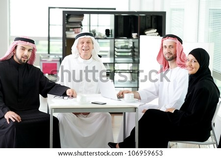 Arabic elderly business with his team at office - stock photo